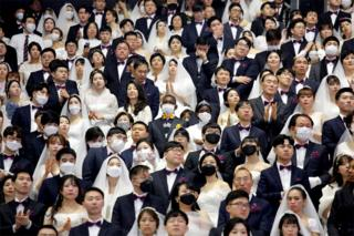 in_pictures Thousands of couples attend a mass wedding