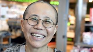 Liu Xia, the widow of Chinese Nobel dissident Liu Xiaobo, smiles as she arrives at the Helsinki International Airport in Vantaa, Finland, on July 10, 2018.