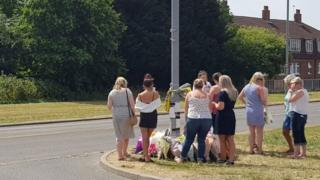 People gathered at the scene of crash