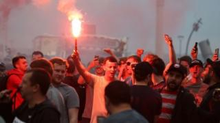 Liverpool fans let off flares outside the Liver Building in Liverpool. PA Photo. Picture date: Friday June 26, 2020