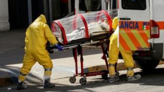 Paramedics move a Covid-19 patient into an ambulance in El Paso, Texas. File photo