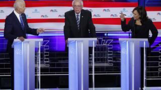 Former Vice President Joe Biden defends his record on racial issues with Senator Kamala Harris