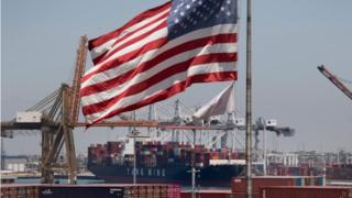 US flag and container ship at Long Beach, California, 1 August 2019