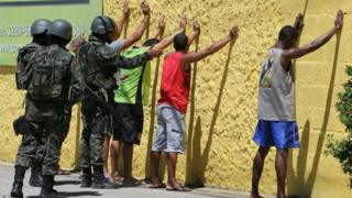 Army soldiers check people, during a military police strike over wages, while patrolling the streets of Vila Velha, Espirito Santo, Brazil, February 11, 2017