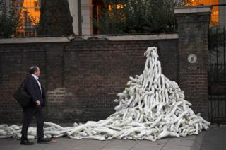 Piles on mannequin limbs are seen outside the Russia's embassy in London
