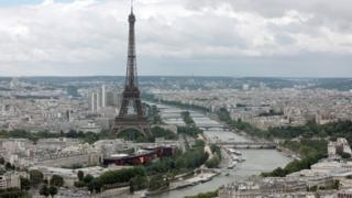 This aerial picture taken on July 14, 2012 shows a general view of Paris with the Eiffel Tower (L) and the Seine River.
