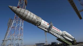 A Proton rocket is lifted on the launchpad at the Baikonur cosmodrome, Kazakhstan