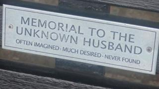 "Bench dedication: ""Memorial to the unknown husband. Often imagined. Much desired. Never found."""