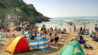 Families on Caswell Bay