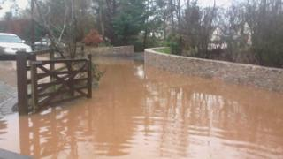Sewage floods in a driveway