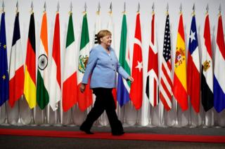 Germany's Chancellor Angela Merkel arrives at the G20 leaders summit in Osaka