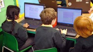 School children working on computer