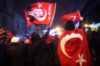 Supporters of Turkish President Recep Tayyip Erdogan shout slogans in front of the Netherlands' consulate in Istanbul, Turkey, 12 March 2017.