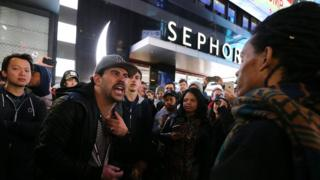 Donald Trump supporters and Hillary Clinton supporters clash outside in Times Square after Republican presidential nominee Donald Trump was declared the winner of the U.S. presidential election