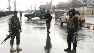Afghan security forces patrolling a street near the site of the attack