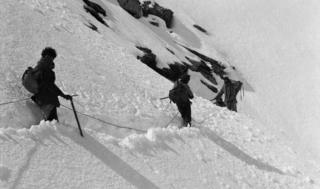 Mountaineers trudge through deep snow