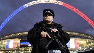 Armed police officer outside Wembley for a France v England game