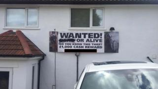Wanted poster on side of Sebastian Stephenson's house