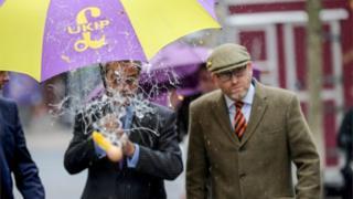 Nigel Farage and Paul Nuttall dodging an egg