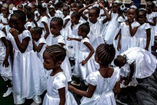 Young Catholic faithful are seen during the inauguration of the new Archbishop of Kinshasa, Fridolin Ambongo in Kinshasa, DR Congo - 25 November 2018