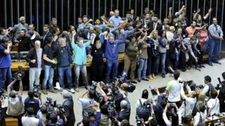 Protesters demanding military rule take over Brasilia chamber of Congress