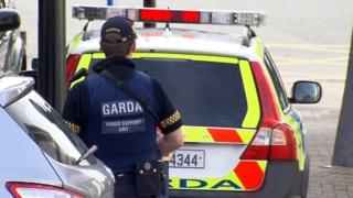 A Garda officer is seen in full uniform and bullet proof vest