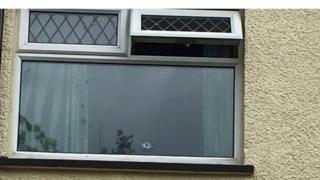 Hole in window at house in the Parkmore area