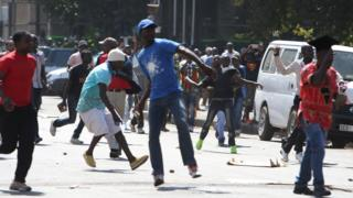 Protesters hurling stones at police in Harare, Zimbabwe - Wednesday 3 August 2016
