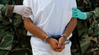 A detainee at Guantanamo Bay US naval base, 26 Aug 04