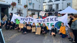 Parents and grandparents join young activists at a climate change protest in Monmouth