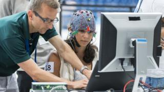 Woman wearing a brainwave-detecting cap