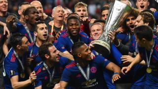 Manchester United with Europa League trophy