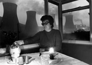 Woman living opposite Ironbridge Power Station eating by candlelight during 1972 electricity power cuts
