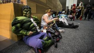 A cosplay enthusiast dressed like the character of The Hulk waits during the 2015 Comic-Con International Convention in San Diego, California 10 July 2015