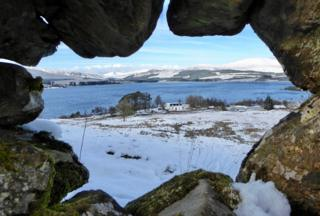 Through the wall of a drystane dyke overlooking Loch Clatteringshaws, Dumfries and Galloway