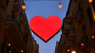 Illuminated signs of Valentine's Day decorate a shopping district in Beirut, Lebanon, 8 February 2017
