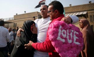 A released detainee hugs members of his family after Egyptian President Abdel Fattah al-Sisi issued a pardon for 203 youths jailed for taking part in demonstrations, as part of a pledge he made months ago to amend a protest law, in front of the main gate of Tora Prison in Tora, Egypt March 14, 2017