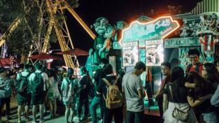 People queue for the haunted house at Halloween event at Ocean Park on October 30, 2015 in Hong Kong. Hallowee