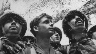 Israeli paratroopers gaze at Western (aka Wailing) Wall moments after recapture of Jewish holy site in Six-Day War, 1967
