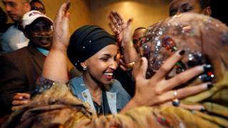 Democratic congressional candidate Ilhan Omar is greeted by her husband's mother