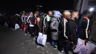 About 150 Libya Returnees wey just land for Murtala Mohammed International Airport in Lagos, on December 5, 2017 dey wait for officials to attend to dem.