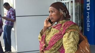 A woman in Tanzania with a phone