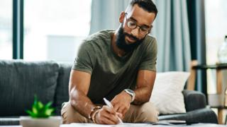 Man works on finances