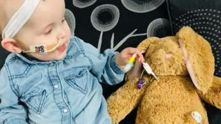 One-year-old Darcey with her tube bunny