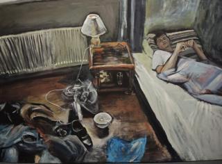 A boy lying in bed.