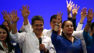 Honduras President and National Party candidate Juan Orlando Hernandez celebrates with supporters and his wife Ana Garcia de Hernandez after the first official presidential election results were released in Tegucigalpa, Honduras, November 27, 2017