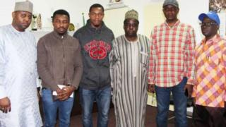 Uchenna Abia and Kenneth Eboh pose with members of the Nigerian Diaspora Commission