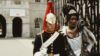 transvestite having her picture taken with a member of the Household Cavalry at Buckingham Palace during Lesbian and Gay Pride, London, 24th June 1995.