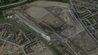 Plans for new homes at the former steelworks were changed after noise concerns and contamination costs