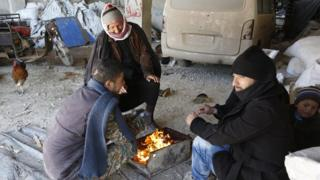 People in Aleppo around a fire at Jibreen shelter centre on 1 February 2017